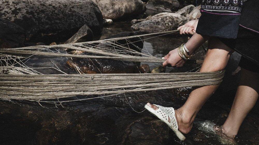 Washing hemp yarn In Lao Chai Village, Sapa, Vietnam