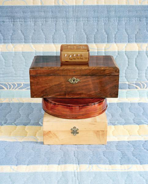 Stacked Jewellery Boxes on Electronic Blanket: Blue, Yellow, Brown
