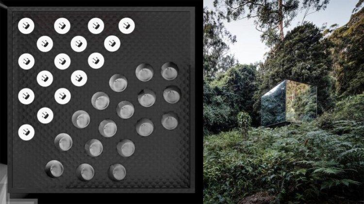 a mirrored cube in a jungle landscape