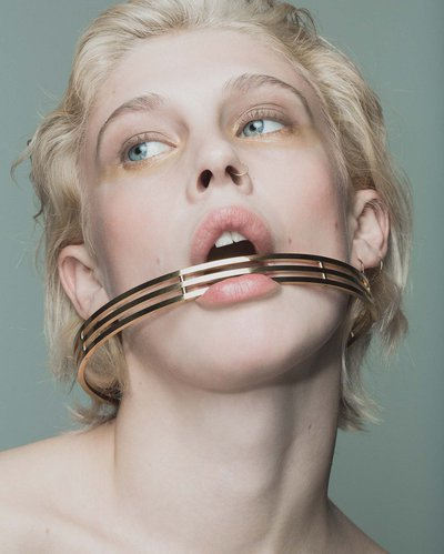 Jake McCombe, model with metal choker in mouth