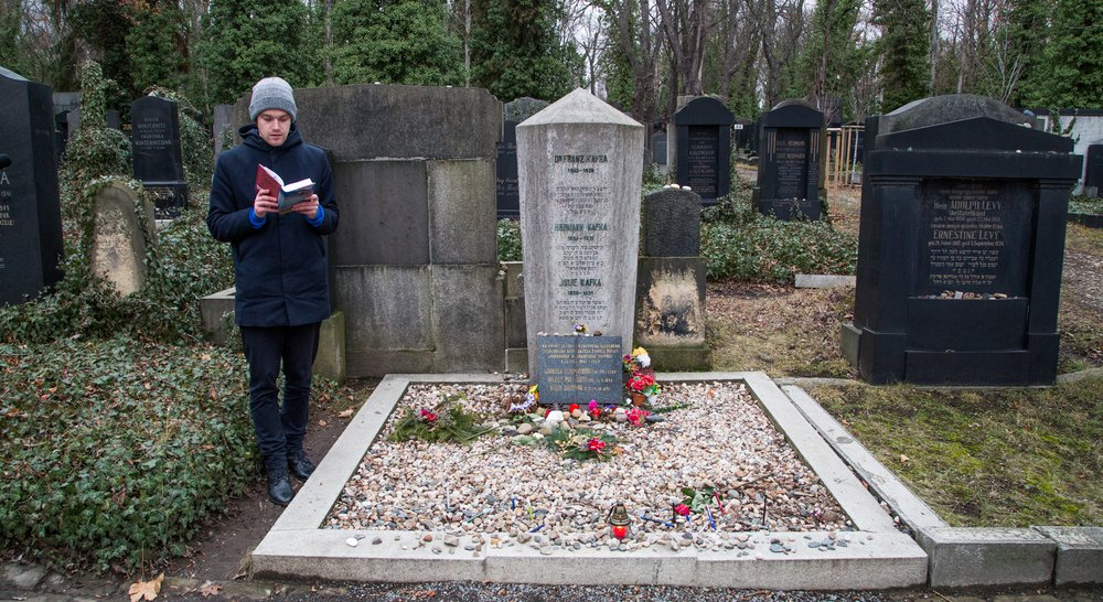 "Reading ""Kafka on the Shore"" next to Franz Kafka's grave"