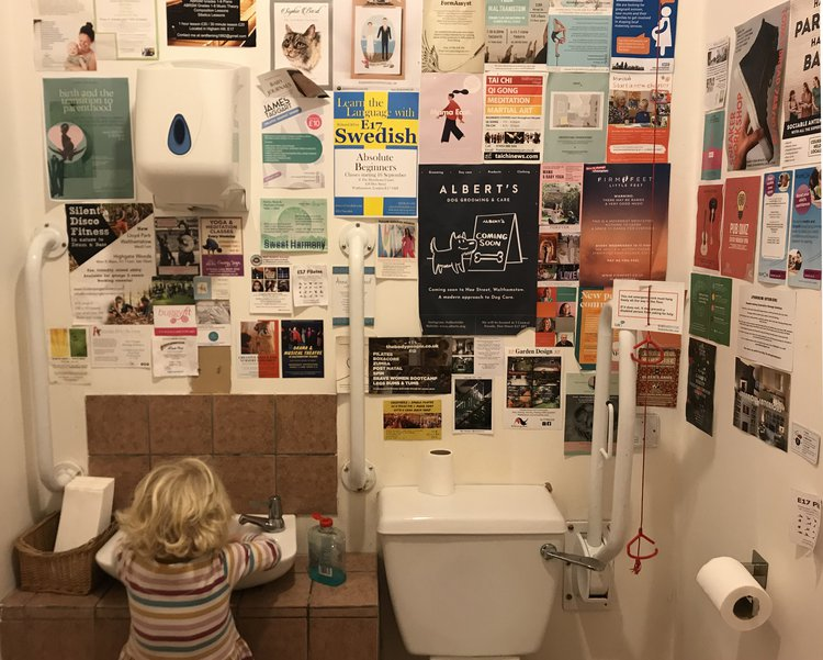 Toilet with leaflets on the wall