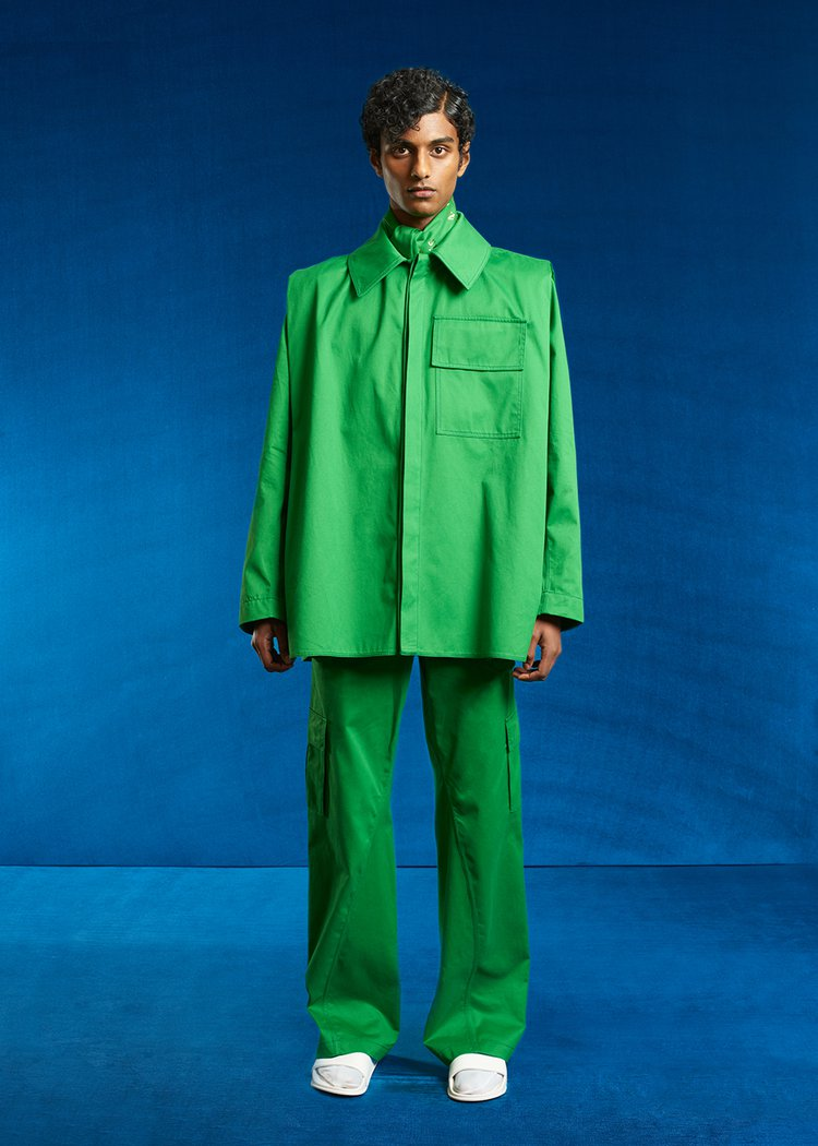 The Pedestrian, Look 4. Male model in bright green suit.
