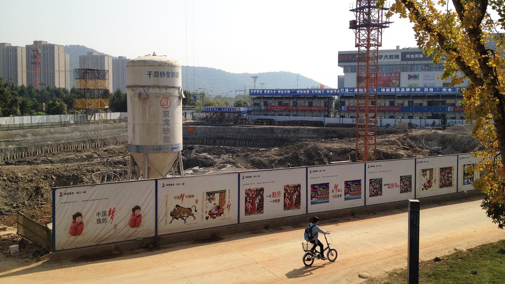 'The Chinese Dream' advertising boards at the construction site of a new Chinese design museum, 24 October 2014.
