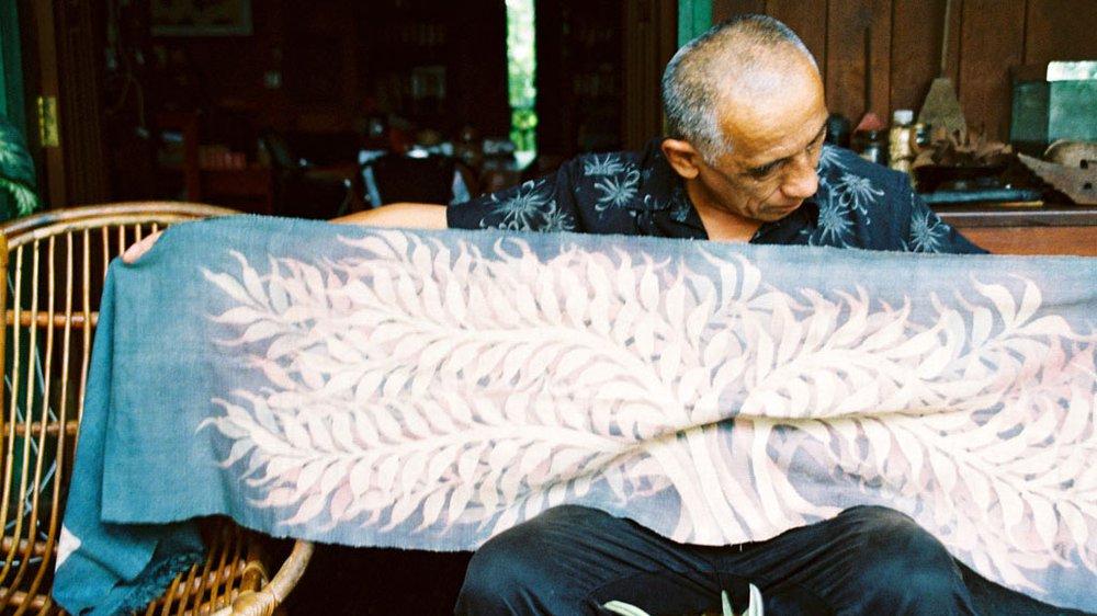 Kikuo Morimoto showing a personal batik work on silk, Siem Reap