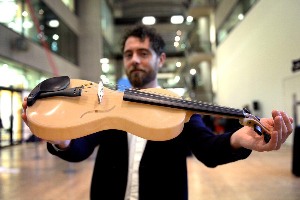 Luca Alessandrini with Spider Silk Violin at International Student Innovation Awards