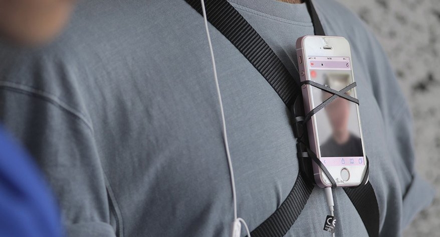 smart phone strapped to someone's chest